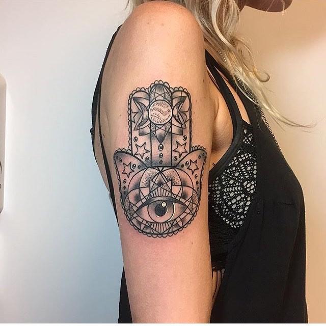 Vintage style black ink shoulder tattoo of Hamsa symbol