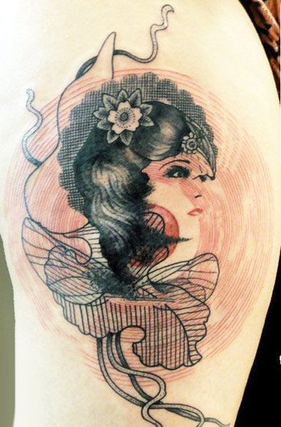 Vintage style black ink shoulder tattoo of woman with flowers