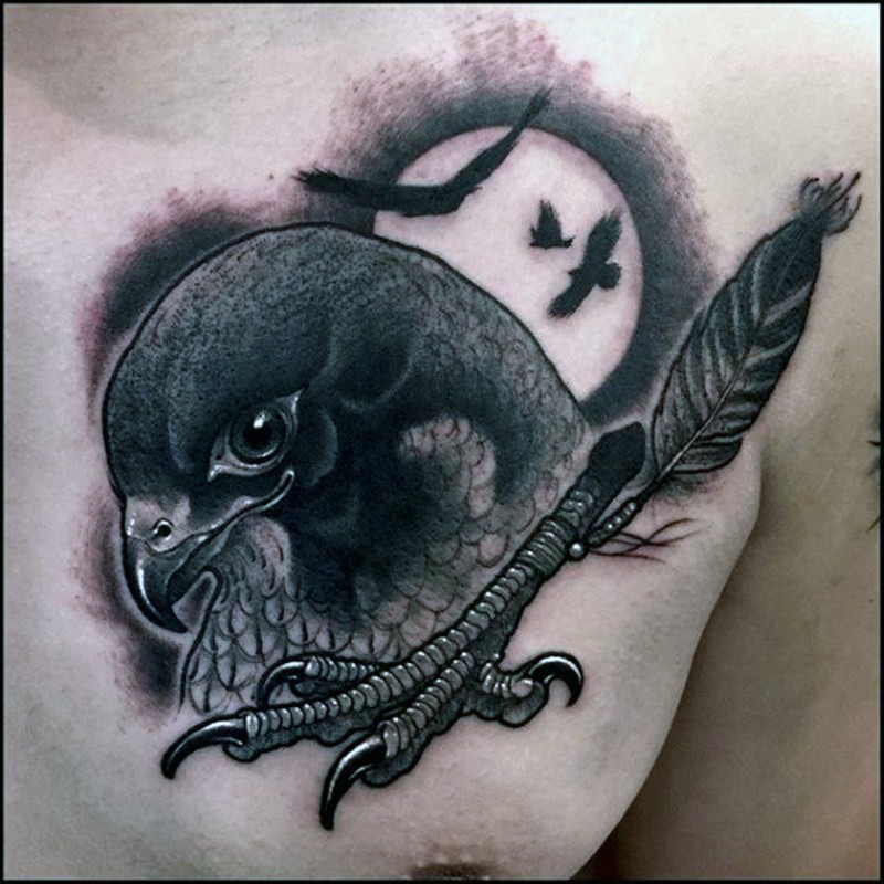 Vintage style black ink strange eagle head combined with eagle leg tattoo on chest stylized with feather