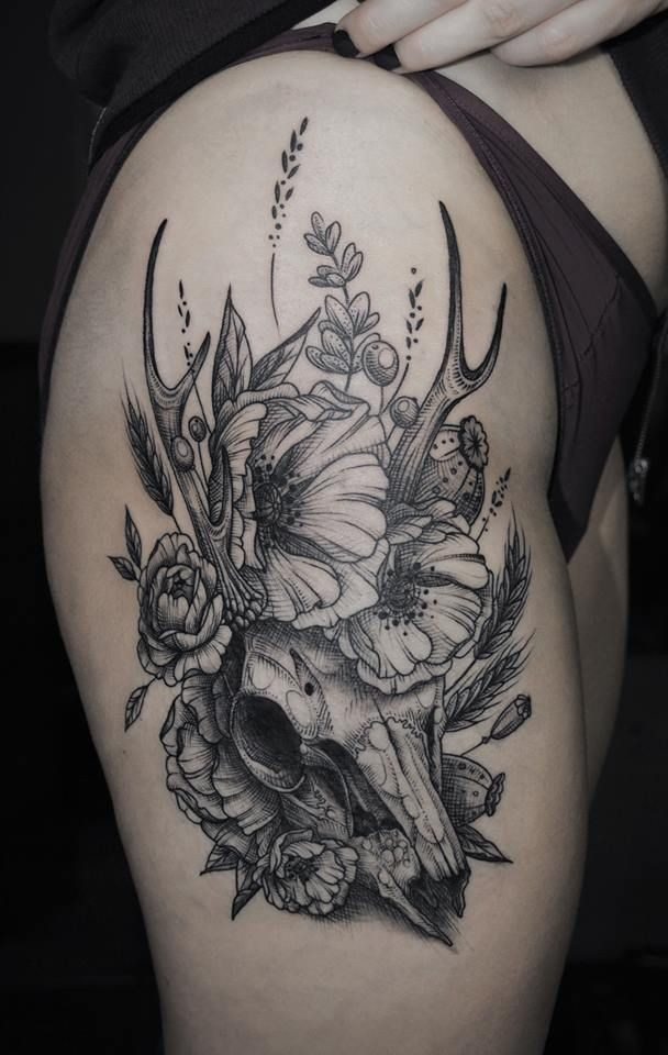 Flower skull thigh tattoo will