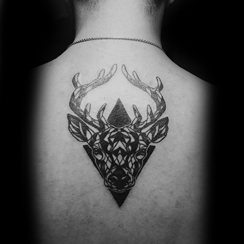 Vintage style black ink upper back tattoo of deer head with geometrical figures