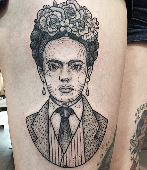 Vintage style black ink woman portrait tattoo on thigh with flowers