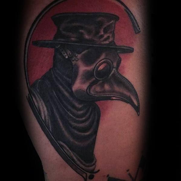 Vintage style colored arm tattoo of plague doctor portrait