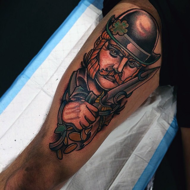 Vintage style colored detailed thigh tattoo on man with knife portrait
