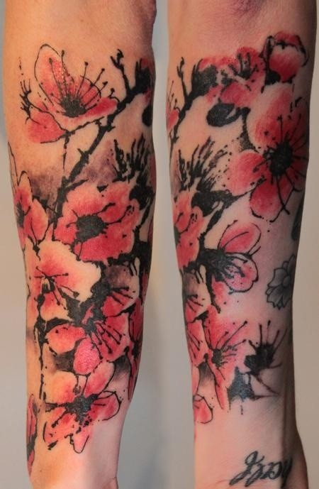 Vintage style colored forearm tattoo of blooming flowers