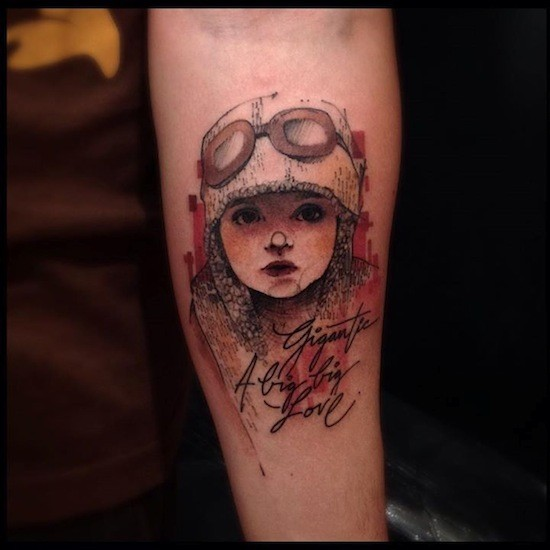 Vintage style colored forearm tattoo of cute girl with signature