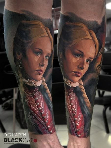 Vintage style colored leg tattoo of beautiful woman in red dress