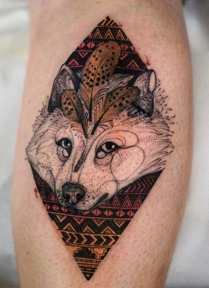 Vintage style colored leg tattoo of white wolf with ornaments by Joanna Swirska