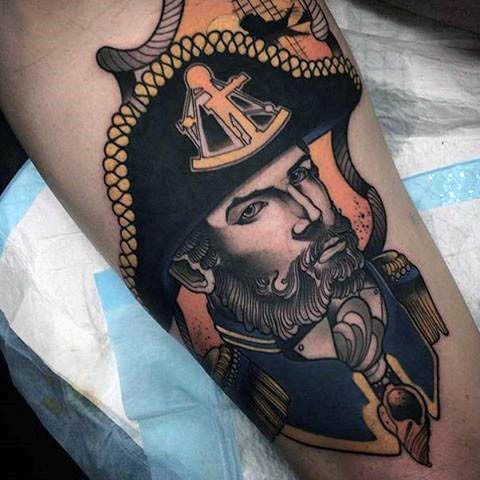 Vintage style colored old sailor portrait tattoo on forearm
