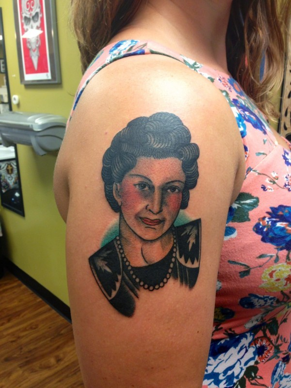 Vintage style colored on shoulder tattoo of old woman portrait