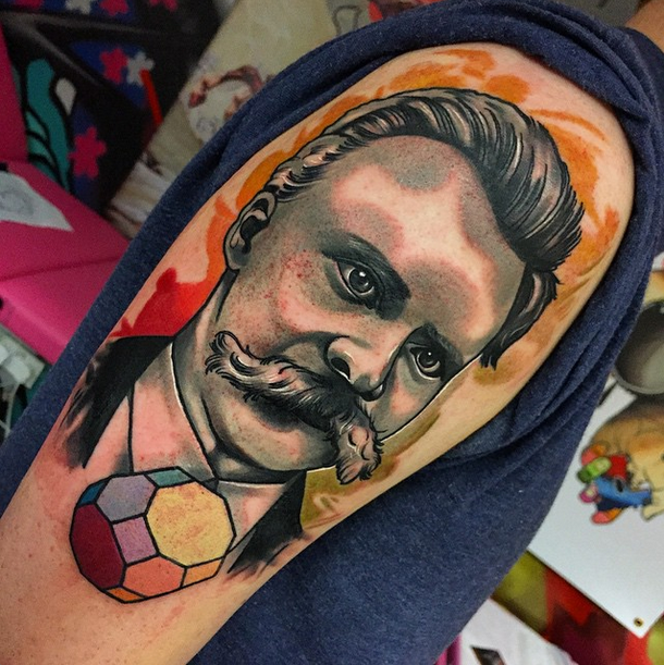 Vintage style colored shoulder tattoo of man with mustache and stone
