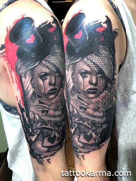 Vintage style colored shoulder tattoo of woman with hat and rabbit