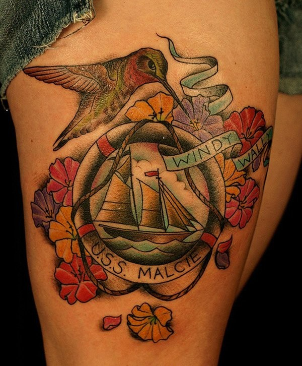 Vintage style colored thigh tattoo of sailing ship portrait with flowers and lettering