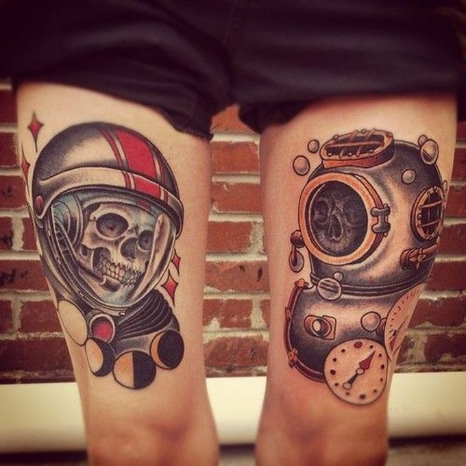 Vintage style colored thigh tattoo of old astronaut and diver suits