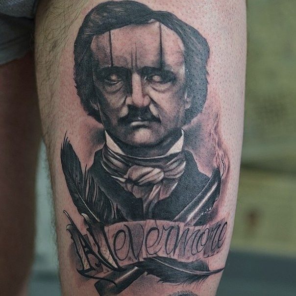 Vintage style demonic like man with feather and lettering tattoo on thigh