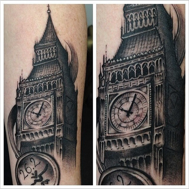 Vintage style detailed arm tattoo of Big Ben tower