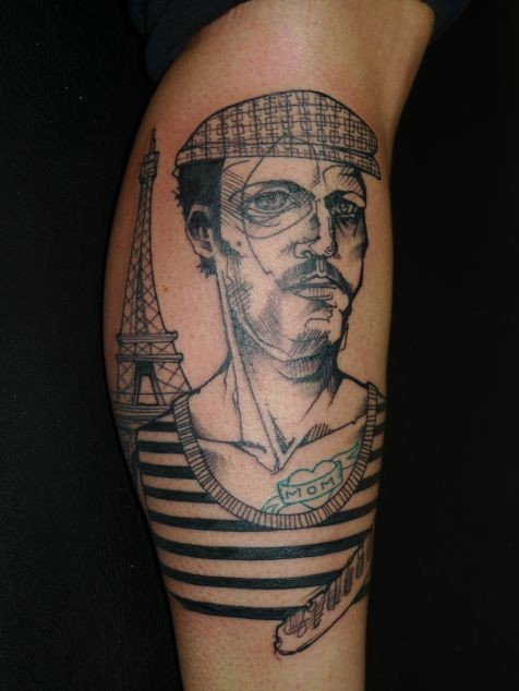 Vintage style detailed arm tattoo of French man with Eiffel tower
