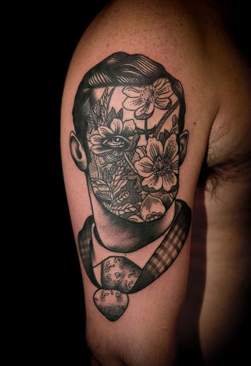 Vintage style painted black and white portrait with flowers instead of face tattoo on shoulder
