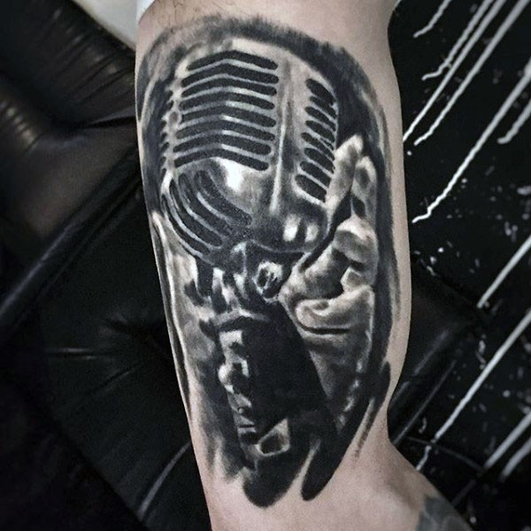 Vintage style painted black and white microphone tattoo on arm