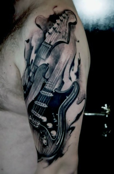 Vintage style painted black and white guitar tattoo on shoulder