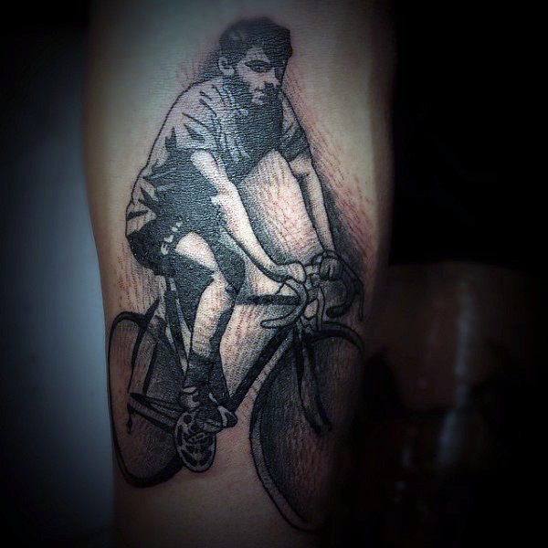 Vintage style painted black and white man on bicycle tattoo on arm