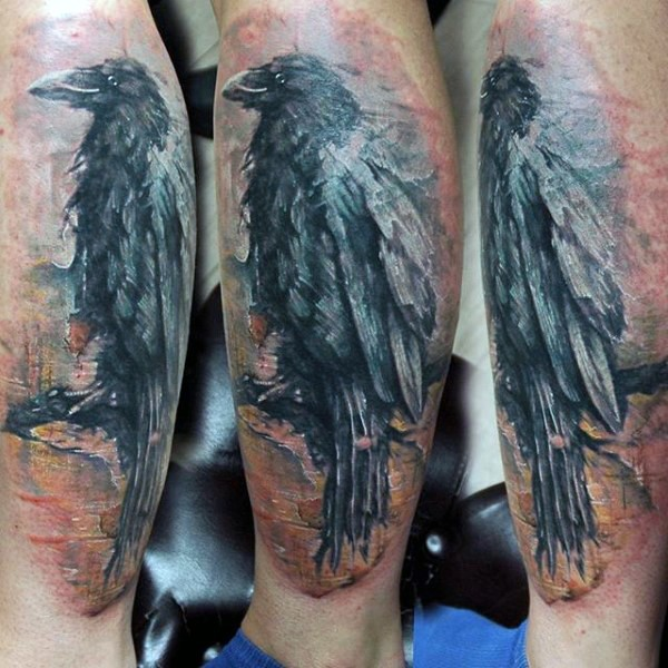 Vintage style painted colored crow tattoo on leg