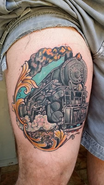 Vintage train portrait thigh tattoo in portraint style