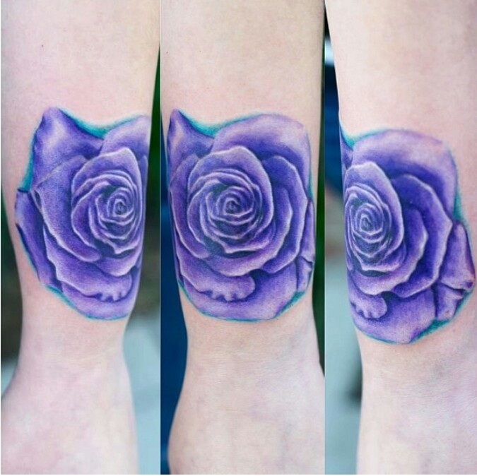 Violet colored arm tattoo of beautiful rose