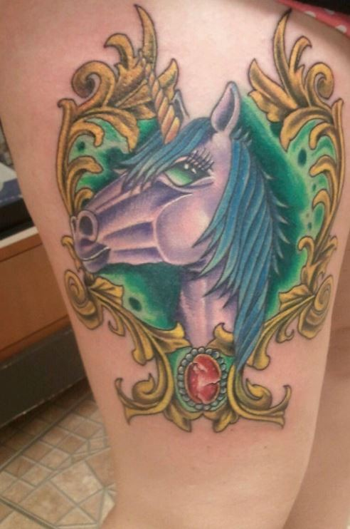 Violet unicorn colored thigh tattoo in gorgeous old style frame