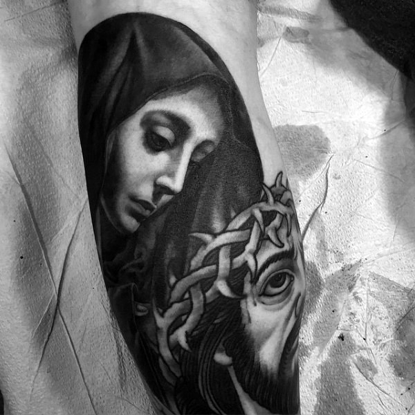 Virgin Mary and Jesus Christ in crown of thorns with bloody face traces religious tattoo