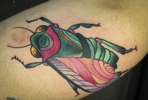 Vivid colors bug tattoo on arm