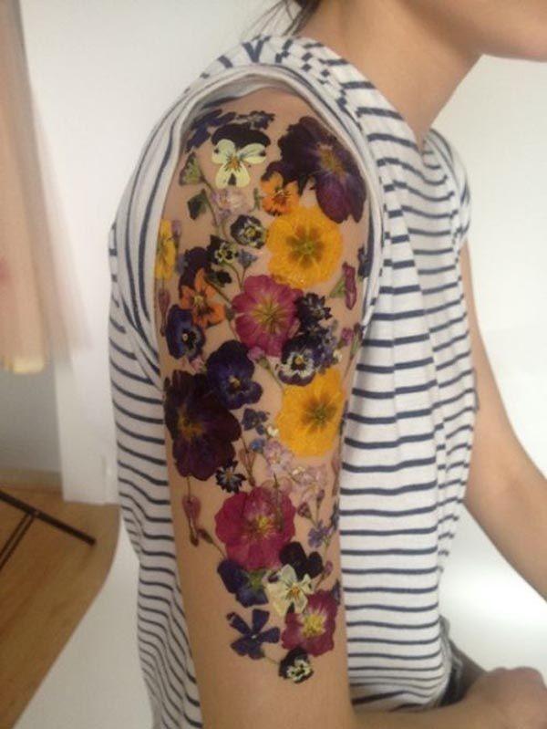 Vivid colors flower tattoo on half sleeve