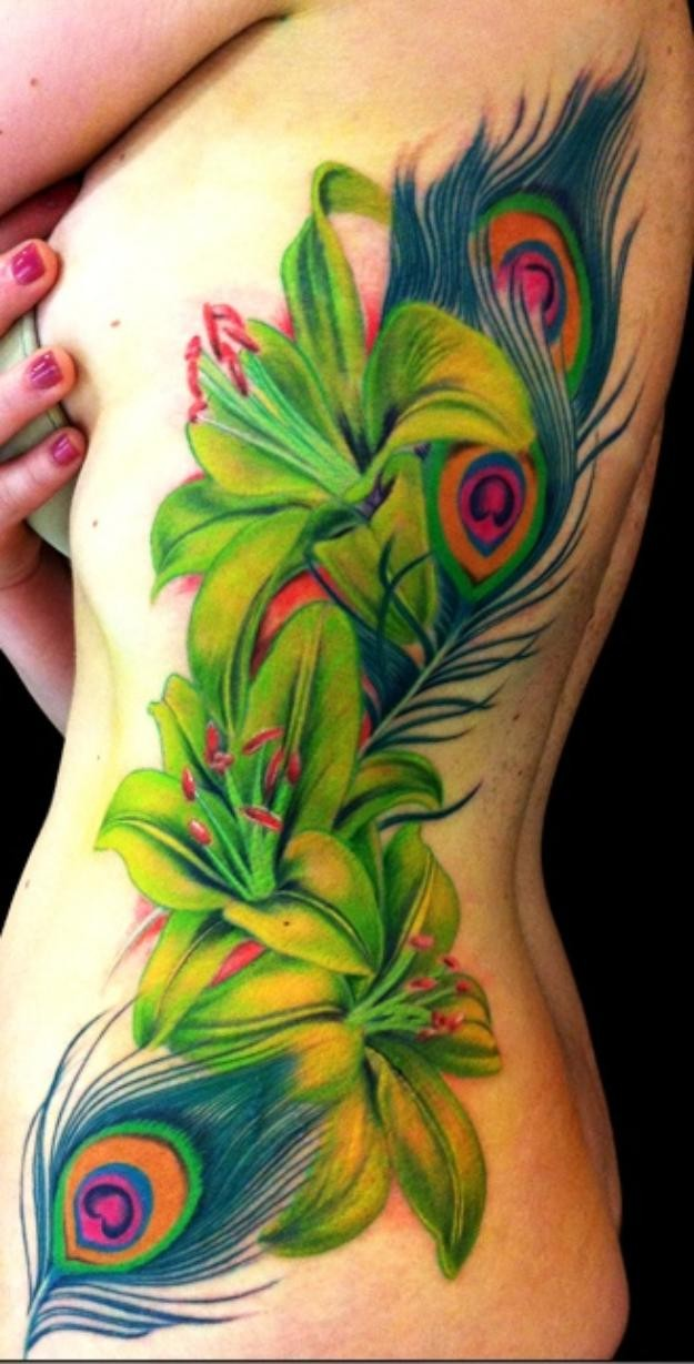 Vivid colors flowers tattoo on ribs