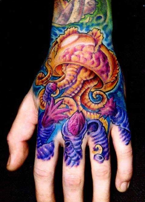 Vivid colors jellyfish tattoo on hand
