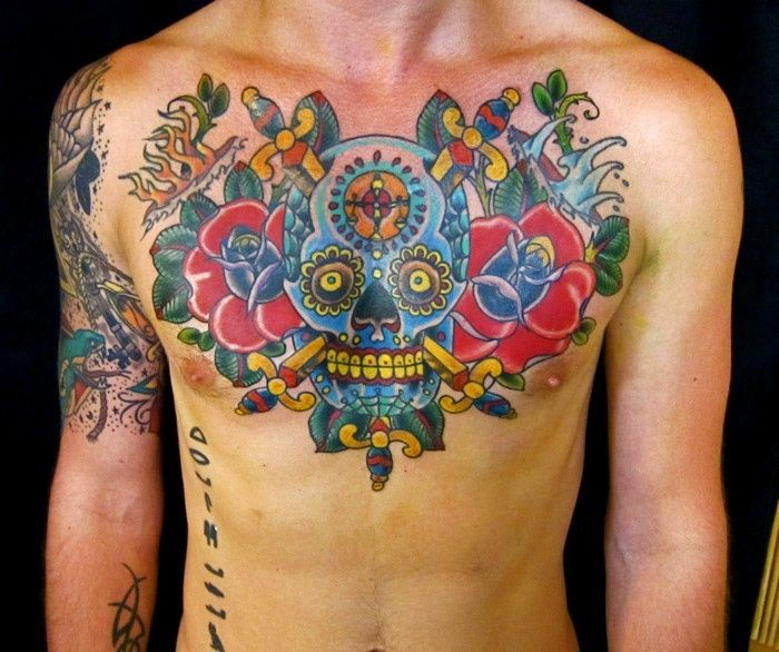 Vivid colors mexican skull chest tattoo