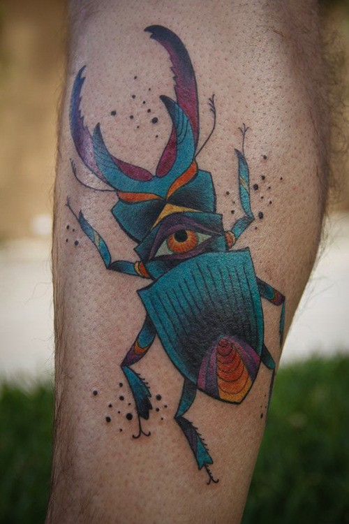 Vivid colors stag beetle with eye tattoo on leg
