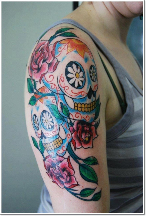 Vivid colors sugar skull tattoo on half sleeve