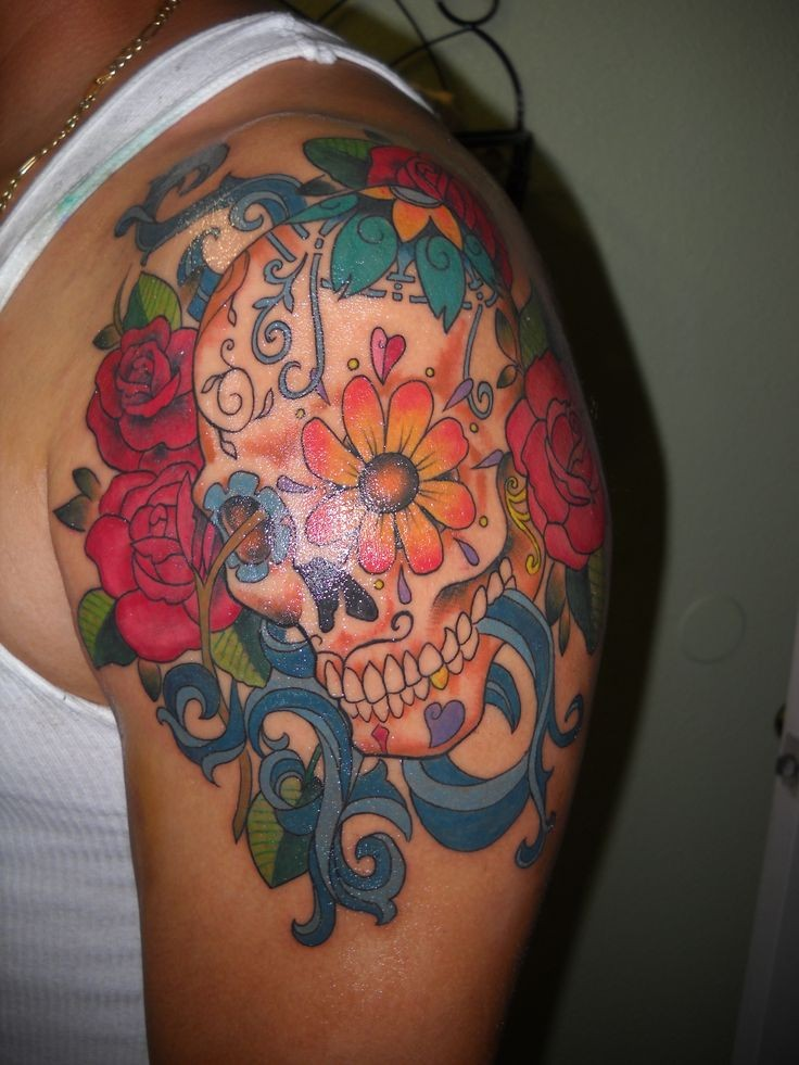 Vivid colors sugar skull tattoo on shoulder