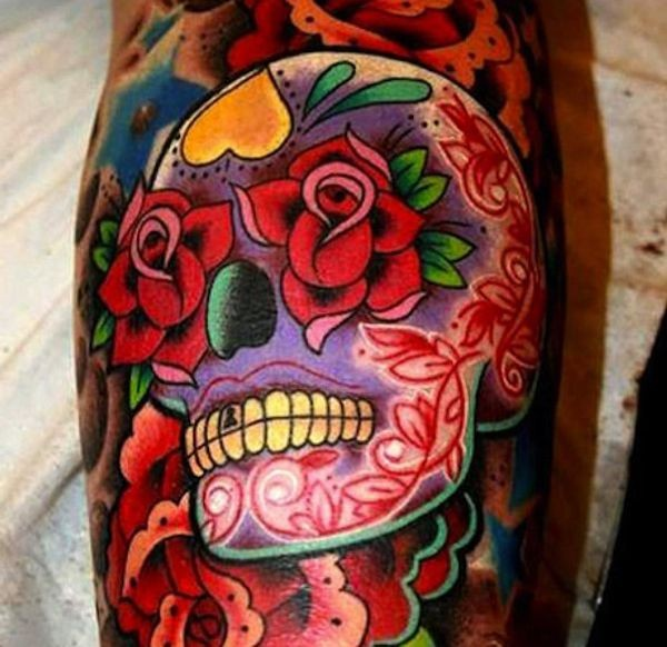 Vivid colors sugar skull with red roses tattoo
