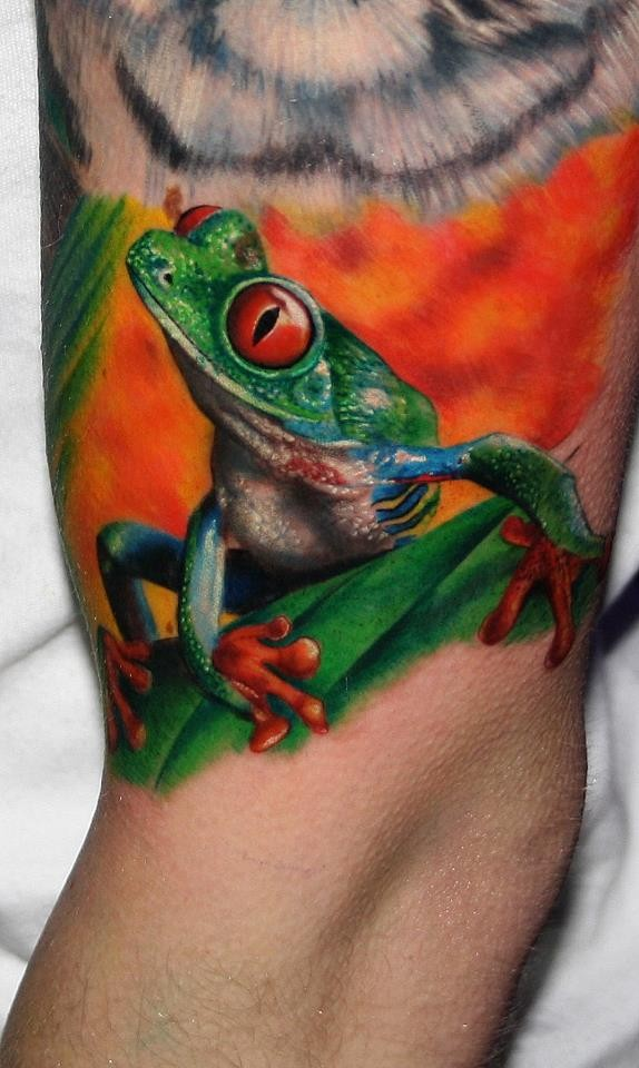 Vivid colors tree frog tattoo on arm