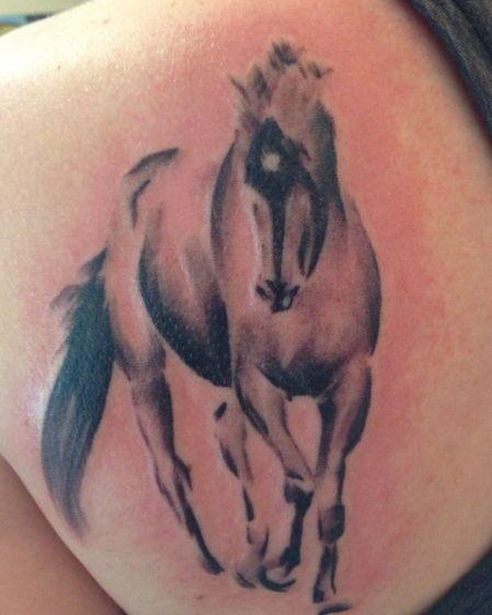 Walking horse tattoo on shoulder  blade