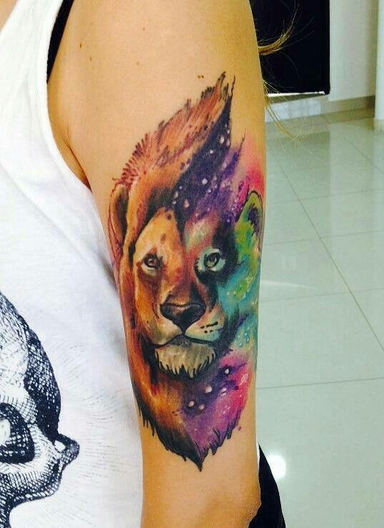 Water color lion in space tattoo