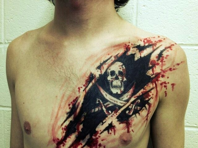 Watercolor  pirate tattoo on chest