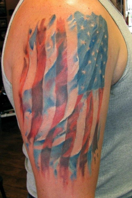 Watercolor american flag tattoo on shoulder