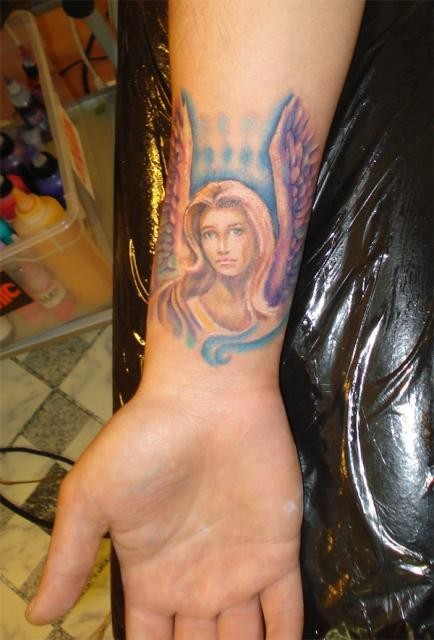 Watercolor angel girl tattoo on wrist