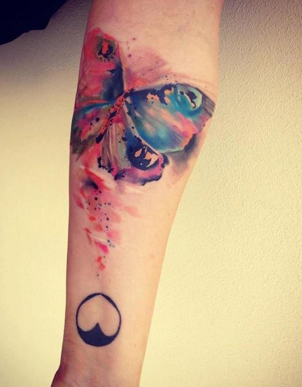 Watercolor butterfly forearm tattoo