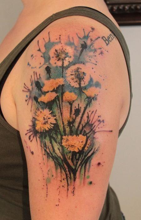 Watercolor dandelions flowers tattoo on arm