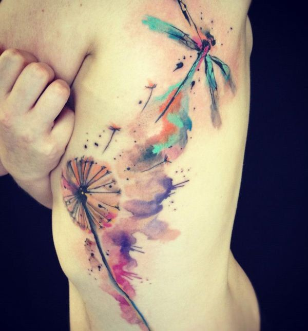 Watercolor dragonfly and dandelion tattoo on ribs