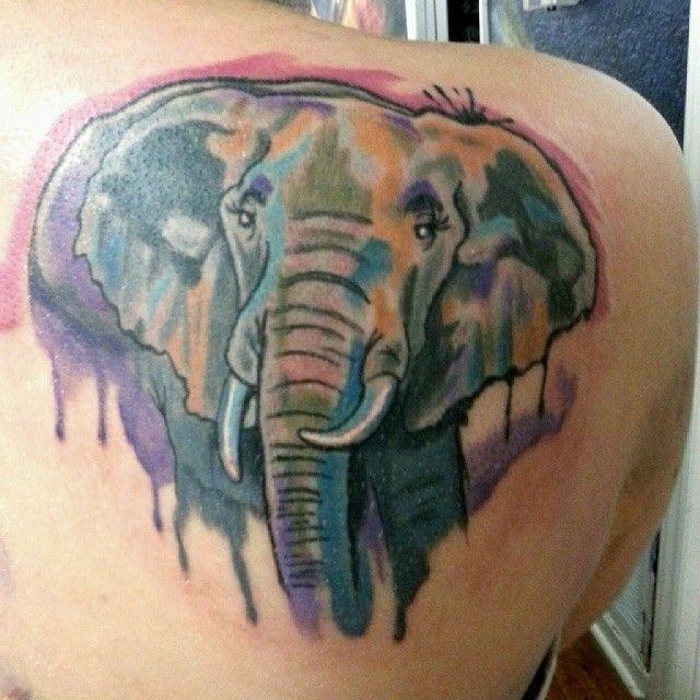 Watercolor elephant head tattoo on shoulder blade