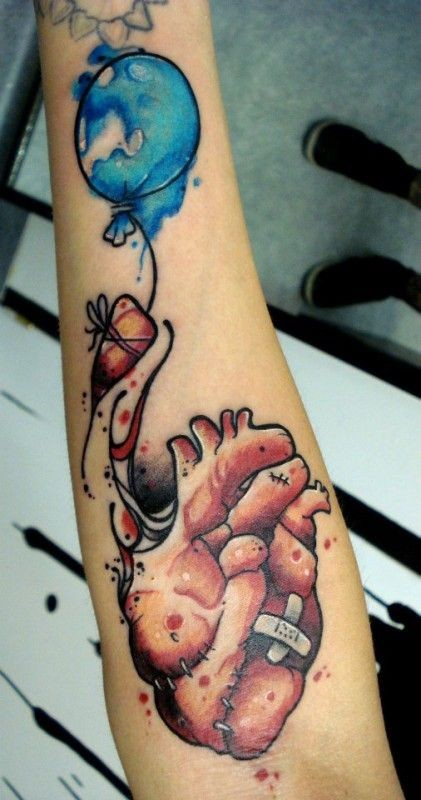Watercolor heart and a balloon forearm tattoo
